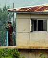 North Korean soldiers man an observation post on the border with South Korea, 18 June 2003