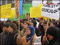 Women with banners at an anti-war protest in Turkey