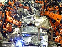 Robots welding cars at VW's Wolfsburg plant