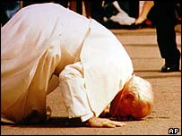 Pope John Paul II kissing the ground, this time in Lithuania