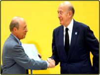President of the European Convention Valery Giscard dEstaing, right, shakes hands with Greek Prime Minister Costas Simitis after handing over a copy of the EU draft constitution