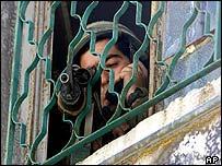 Israeli soldier guards blast site in Zawata