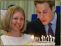 Erin Jones, 17, gives William a birthday cake at the Anglesey Food Fair, North Wales