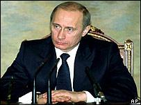 Russian President Vladimir Putin fielding questions from reporters at the Kremlin