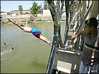 A young Iraqi dives into a tributary of the Shatt al-Arab river in Basra