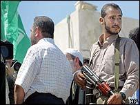 Hamas's Ismail Abu Shanab (L) speaks to reporters in Gaza