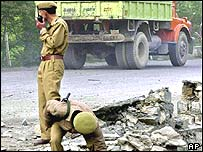 Indian police inspect blast site south of Srinagar