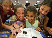 Girls reading the new Harry Potter book at Borders Books in Plano, Texas