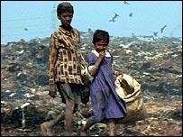 Children scavenge on a city dump near Dakar