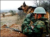 Guard looks into Kosovo from Serbian territory