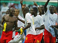 Geremi (left) is congratulated by his Cameroon team-mates