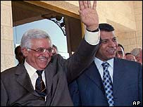 Abu Mazen (left) and Mohammed Dahlan see US Secretary of State Colin Powell (not seen) off after his visit