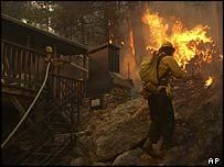Crews from Corona de Tucson and Three Points Fire Department battle the Aspen fire (AP Photo/Arizona Daily Star, David Sanders)
