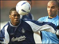 Collin Samuel (left) in Scottish Cup action for Falkirk against Dundee
