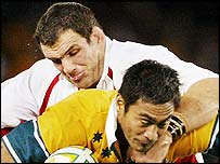 England captain Martin Johnson gets to grips with Australia's Steve Kefu