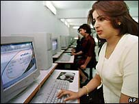 A file picutre of women surfing the internet in Baghdad