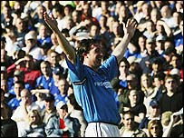 Robbie Fowler celebrates in front of the Manchester City faithful