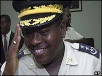 Jean-Robert Faveur, 37, salutes a fellow officer during his first moments in office on 6 June