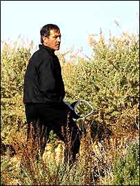 Seve Ballesteros looks for a lost ball