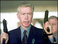 California governor Gray Davis shows semi-automatic guns