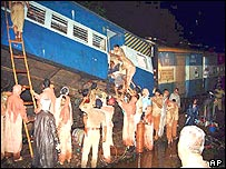 Rescue workers free survivors from derailed carriages