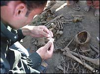Man searches a grave site near Babylon, Iraq