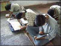 School children in India working without desks