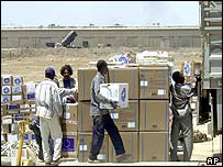 Medical supplies are loaded on to trucks at Baghdad airport