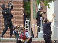 Emergency workers rescue a woman from the building