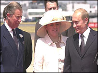 Prince Charles, the Prince of Wales (left) with Russian President Vladimir Putin (right) and his wife, Lyudmila at Heathrow Airport, London