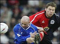 QPR's Kevin Gallen challenges Oldham's Darren Sheridan