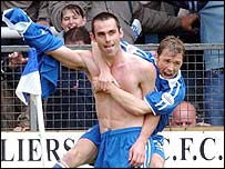 Cardiff striker Peter Thorne celebrates his goal with Andy Legg