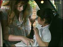 Mother and child in a car