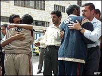 Palestinian prisoners hug their families after being released in Hebron