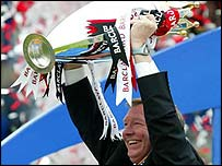 Sir Alex Ferguson with the Premiership trophy