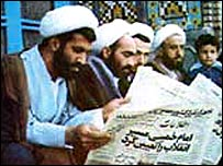 Iranians reading newspapers