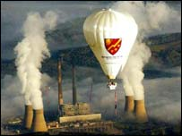 Hot air balloon over factory in USA