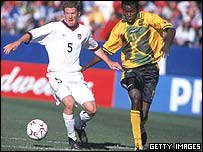 Theodore Whitmore (right) in action for Jamaica