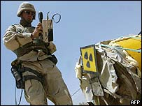A US radiation expert reads the radio active levels on a mixing vat allegedly stolen by looters and dumped