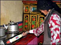 A Tibetan woman with a new gas cooker