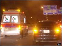 An ambulance rushing to the site of the bombings in Saudi Arabia