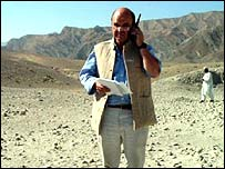 BBC reporter using satellite phone