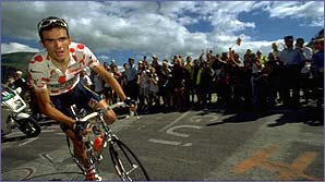 Frenchman Richard Virenque wearing the polka-dot jersey on a steep mountain climb