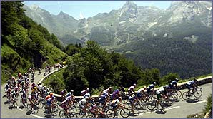 The peloton climbs a steep mountain pass