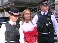 Alain Robert with police