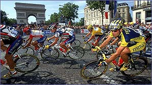 The riders pass the Arc de Triomphe in Paris