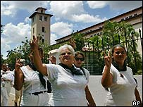 Families of jailed Cuban dissidents demonstrate outside of the Santa Rita Church in Havana