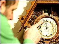 Man adjusting time on a clock