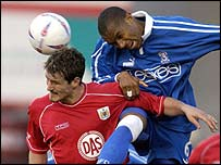 Cardiff defender Daniel Gabbidon (right) beats Lee Peacock