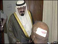 Prince Abdullah visits one of the injured people at a hospital in Riyadh Tuesday 13 May